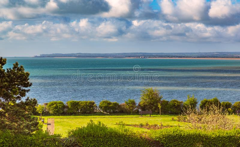 View over the sea towards Deal and Sandwich in Kent, UK whilst the sun shines on a park rose garden area of the Royal Esplanade,. Ramsgate stock images