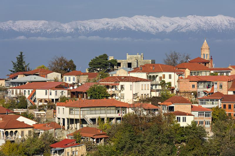 Sighnaghi, a small town in the Kakheti region, in Georgia with the Caucasus Mountains on the background. View over Sighnaghi in Georgia, Caucasus royalty free stock images