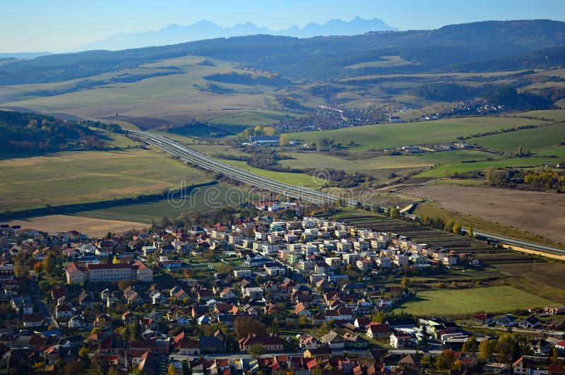 Spišské Podhradie and Slovak Countryside in the Presov region. View over Spišské Podhradie from Spis Castle and Beautiful rolling fields and hills in stock photos
