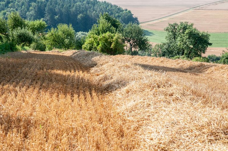 Rural landscape in swabian alb with stubble field. View over stubble field to hedgerows in rural landscape in swabian alb in germany royalty free stock photos