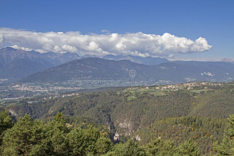 View over the Val di Non. View from the Predaia plateau in the Val di Non to the mighty mountain range of the Brenta group royalty free stock image