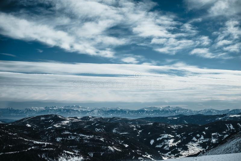 View over a valley in Austrian Alps. Photographed from slope in Turracher Hoehe in February. royalty free stock photos