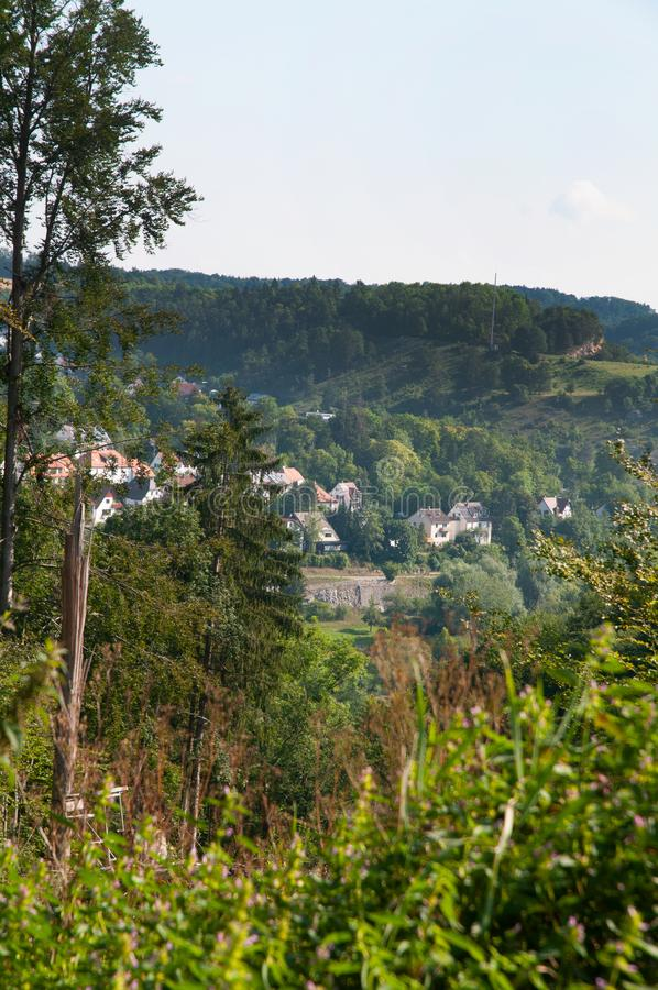 Landscape in swabian alb with village at hill slope. View over valley in swabian alb in germany to village at hill slope royalty free stock image