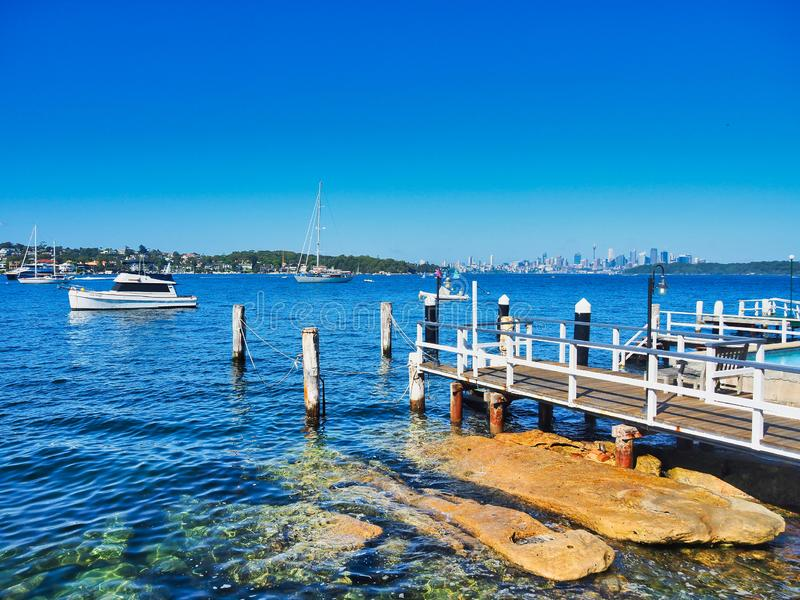 View Over Watsons Bay, Sydney harbour, Australia. View of Watsons Bay, Sydney Harbour, NSW, Australia, with private wharfs or jetties, recreational boats moored stock photos