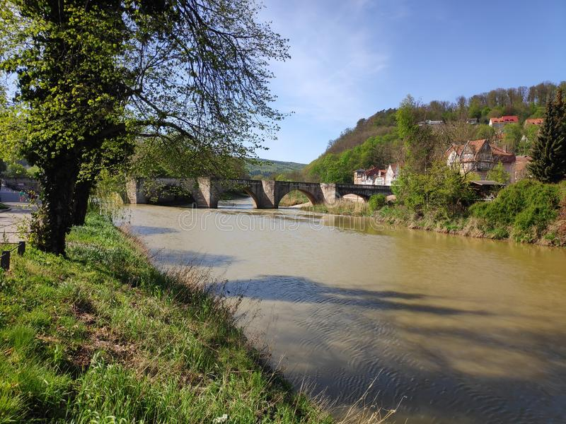 View over the Werra river in Hann. Munden to the old stone bridge stock photo