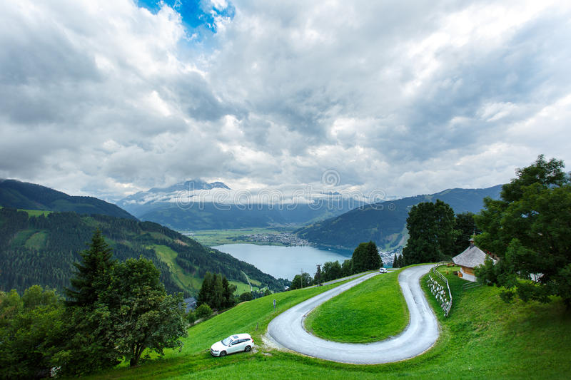 View over Zeller See lake. Zell Am See, Austria, Europe. Serpentine mountain road royalty free stock images