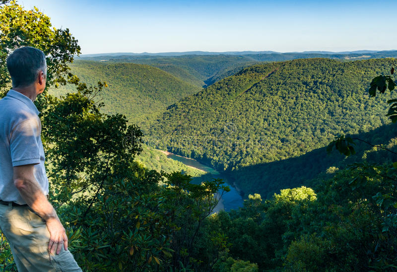View from Overlook in Snake Hill WMA in WV. Senior adult hiker overlooks the Cheat River Canyon from Snake River Wildlife Management Area near Morgantown in West royalty free stock photography