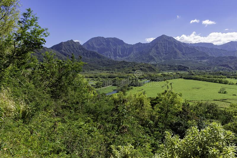 View overlooking the Na Pali coast and fields in the Hanalei River valley Princeville Kauai Hawaii USA stock image