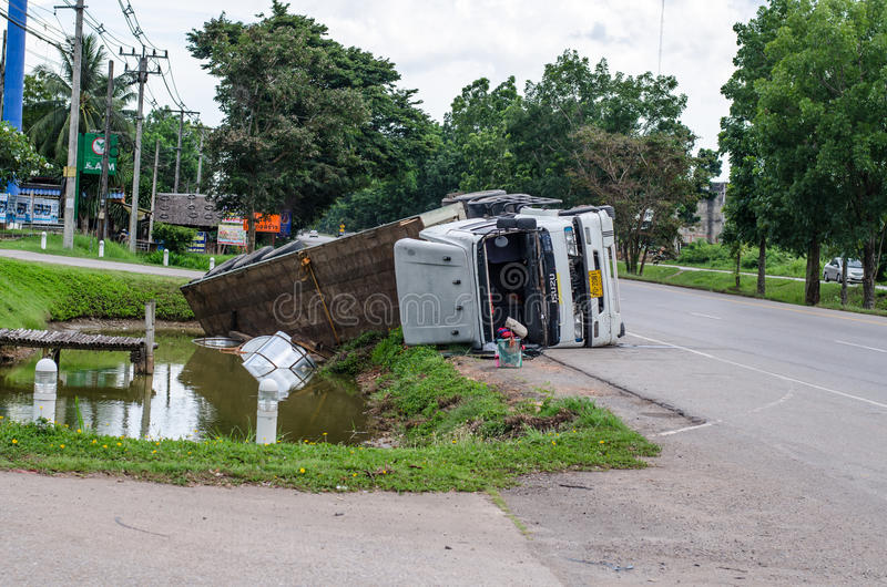A view of an overturned truck on an highway in an accident stock images