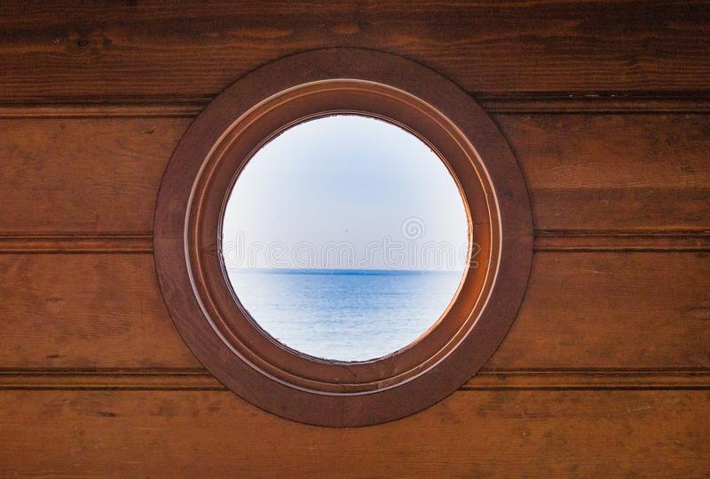 View of Pacific ocean through a round window royalty free stock photo