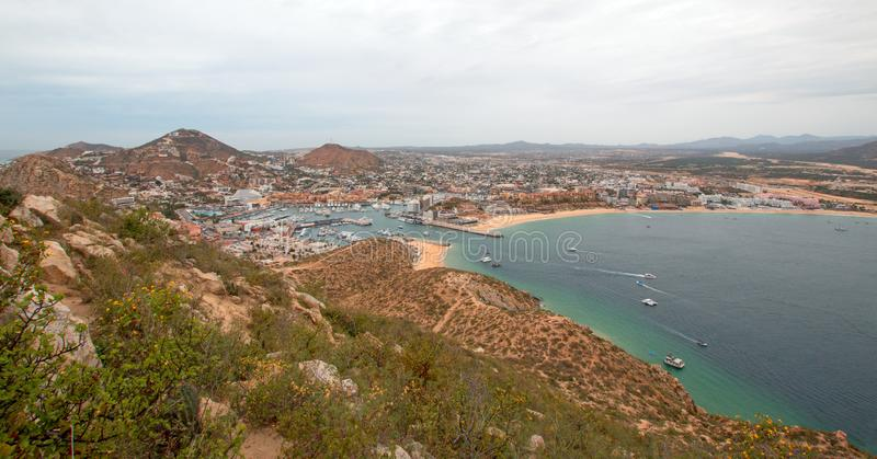 View of Pacific and Sea of Cortes and Cabo San Lucas marina as seen from the top of Mount Solmar in Baja California Mexico royalty free stock photo