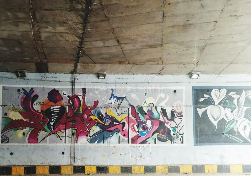 View of painted wall inside the tunnel. Street art and art work with painting. Street art and art work insight the tunnel royalty free stock image