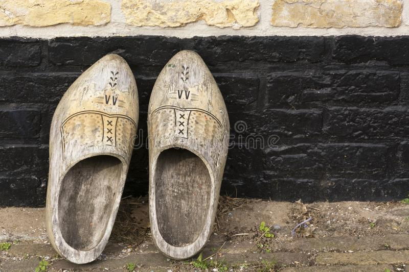 View on a pair of traditional vintage Dutch old decorated wooden shoes stock photo