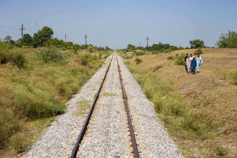 View of Pakistan railway line in Peshawar and People run a way. PESHAWAR, PAKISTAN - Sept 27: view of Pakistan railway line in Peshawar and People run a way, on stock photos