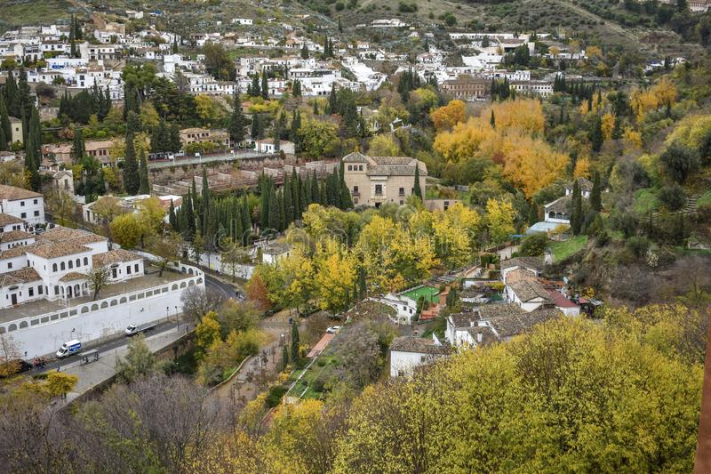The view from the palace of Granada, Spain. The view from the palace walls in Granada, Spain, showing the effects of autumn on the trees of the city royalty free stock image