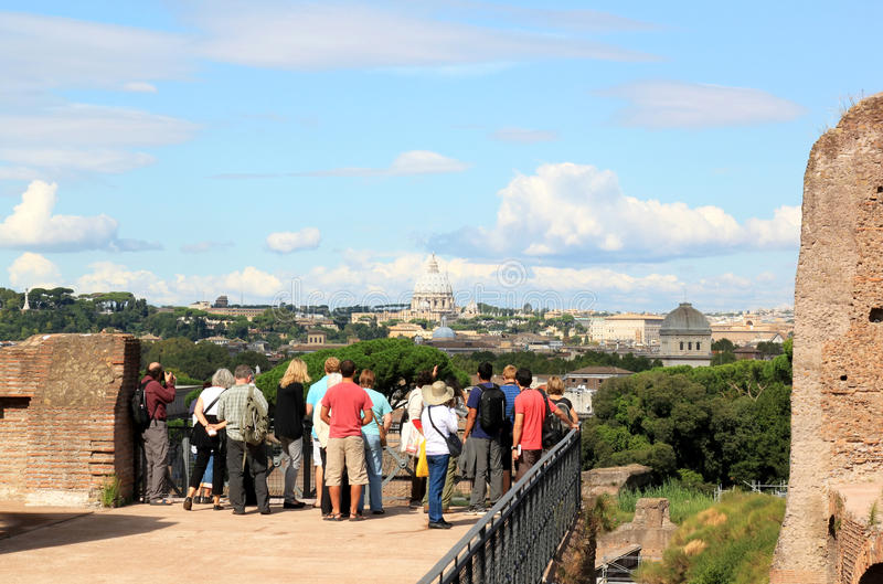 View from the Palatine Hill at the Papal Basilica in Rome. A group of tourists is watching the Saint Peter's Basilica in the Italian capital of Rome from the royalty free stock photo