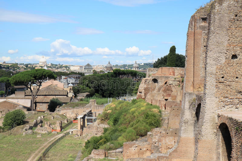 View from the Palatine Hill at the Papal Basilica, Rome, Italy. View from the Palatine Hill in the Italian capital Rome along the ancient remains at the Saint royalty free stock photos