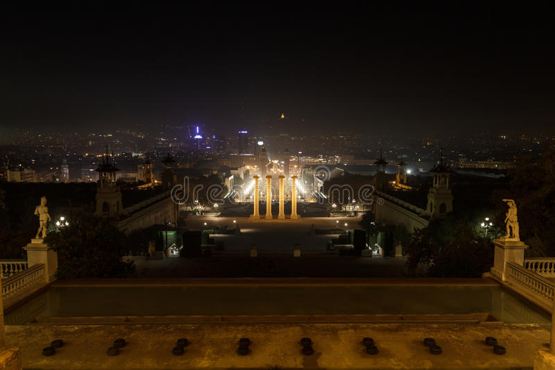 View from Palau Nacional towards the Four Columns and Placa d Espanya at night in Barcelona royalty free stock image