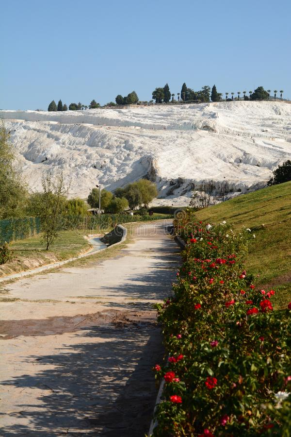 View of Pamukkale from Natural park. Denizli province. Turkey. Pamukkale, meaning cotton castle in Turkish, is a natural site in Denizli in southwestern Turkey stock photo