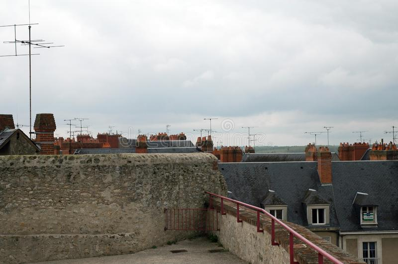 View from panoramic terrace over roofs. View from panoramic terrace in Blois, France, over slat roofs with chimneys and antennas stock photography