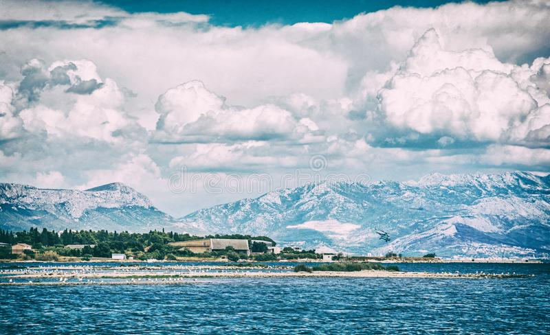 View from the Pantan Beach in Trogir, analog filter. View from the Pantan Beach in Trogir, Croatia to the hills. Travel destination. Analog photo filter with royalty free stock images