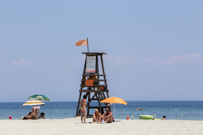View of the parasols at the beach of Katerini in Greece. Katerini, Greece- July 7, 2015: View of the parasols at the beach of Katerini in Greece stock image