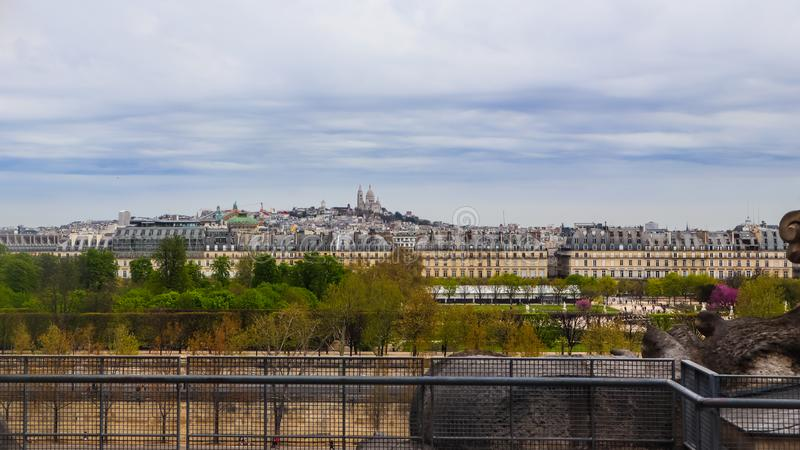 View of Paris city and Sacre Coeur Basilica on Montmartre hill in Paris France. April 2019 stock photos