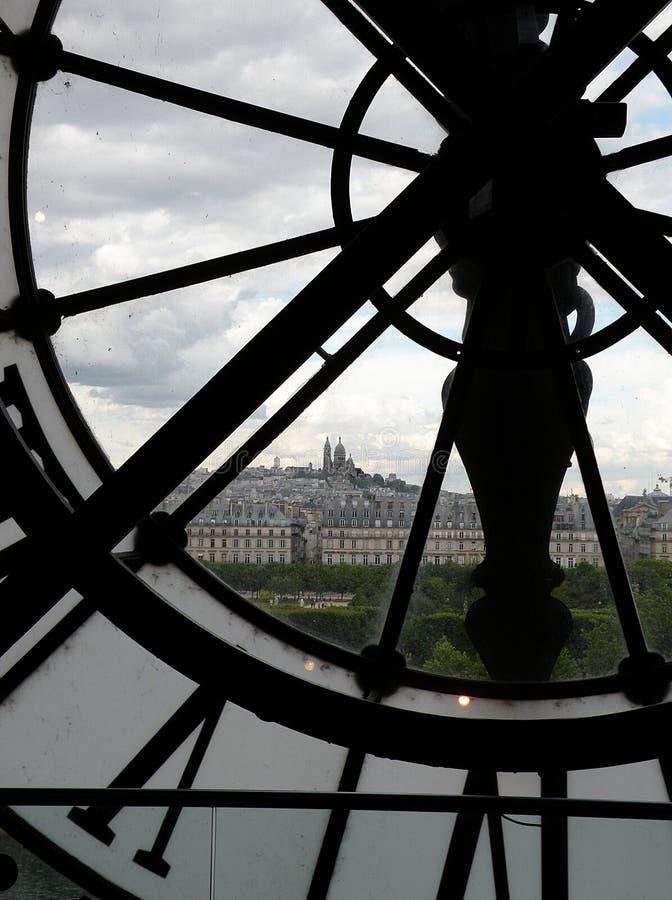 Paris, through the clock face stock photography