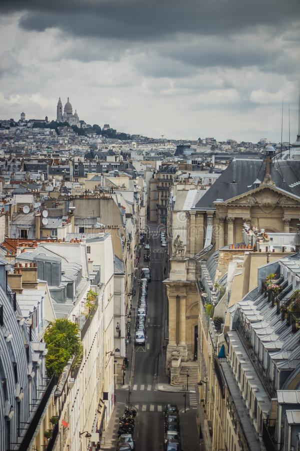 View of Paris, Rue Saint-Roch with Sacre Coeur basilica in the background stock images
