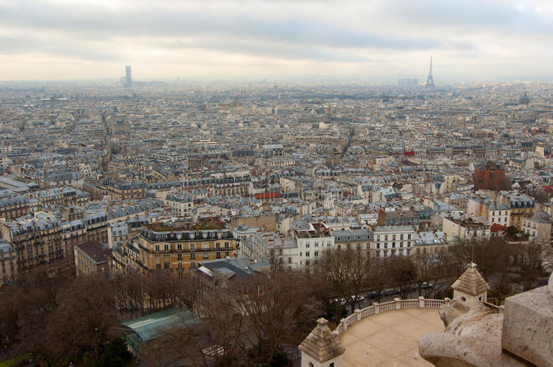 View of Paris from Sacre Coeur Basilica. Aerial view of Paris from Sacre Coeur Basilica with Montparnasse Tower and Eiffel Tower on the horizon royalty free stock images