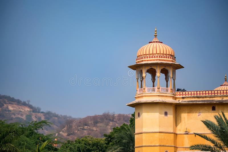 Tower of beautiful Indian style palace. View of part of white Indian palace with trees in background on sunny day royalty free stock images