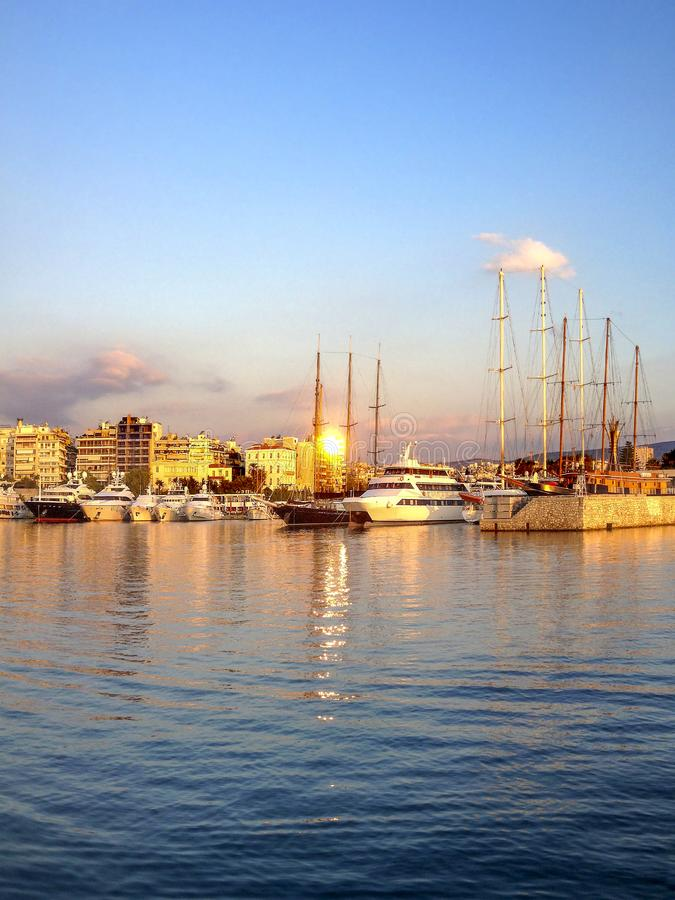 View of Pasalimani marina at sunset. Piraeus city, Greece royalty free stock photography