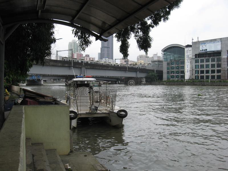 View of the Pasig river and MacArthur bridge, from the Lawton ferry terminal, Manila, Philippines. View of the Pasig river and MacArthur railway bridge from stock photography
