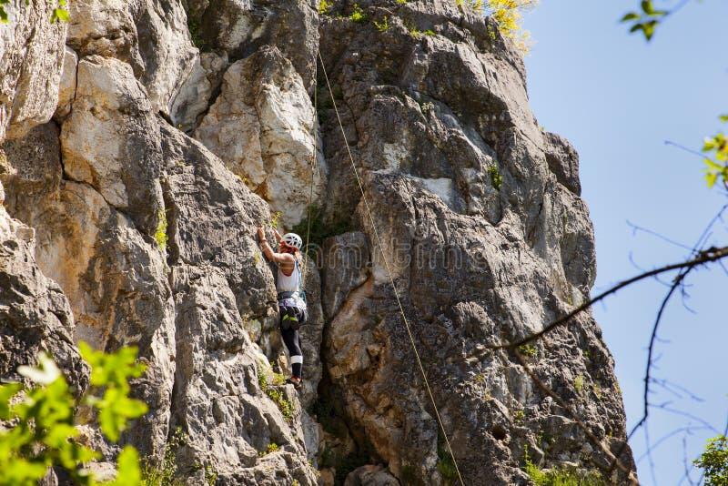Female Climber on Doberdò crag. View of a passionate female Climber on Doberdò crag stock photo