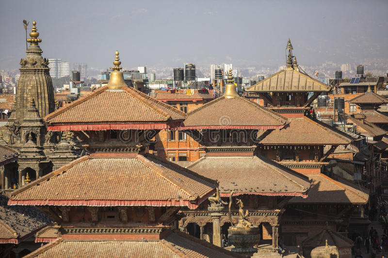 View of the Patan Durbar Square. It is one of the 3 royal cities in the Kathmandu, a very popular spot for tourists. KATHMANDU, NEPAL - CIRCA DEC, 2013: View of royalty free stock photography
