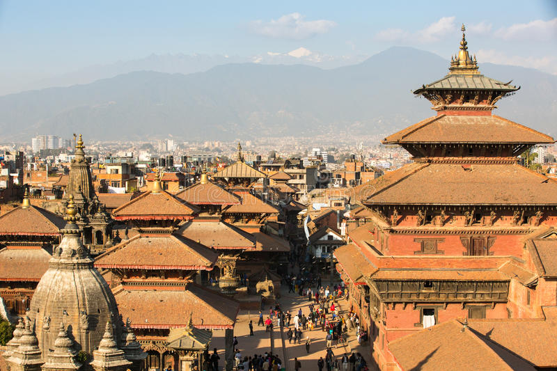 View of the Patan Durbar Square - it is one of the 3 royal cities in the Kathmandu, a very popular spot for tourists. KATHMANDU, NEPAL - DEC 5, 2013: View of royalty free stock image