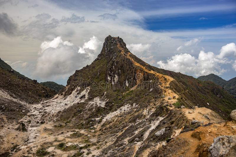 View on path leading to conical peak of Mount Sibayak Gunung, Dolok active volcano royalty free stock images