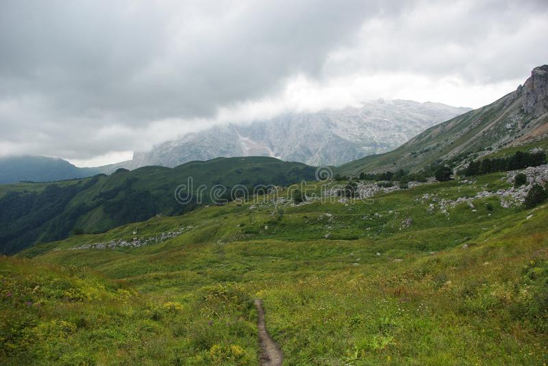 View on path and valley, Russian Federation, Caucasus,. July 2012 stock images