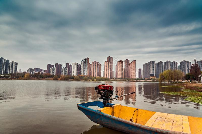 Peaceful lake view and urban building. A view of peaceful lake view and urban building with white clouds and blue sky stock images