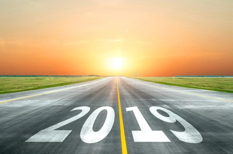 View of the peaceful open road against the setting sun forward to new 2019 year. Concept of success in the future. stock images