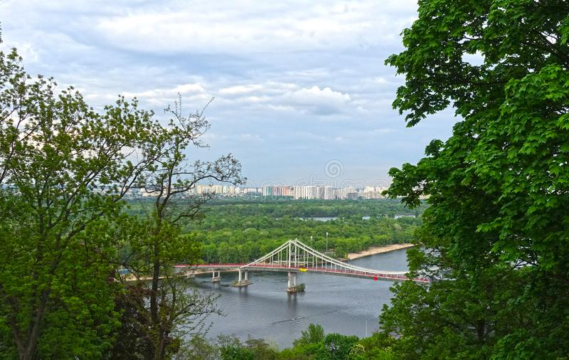 View of the pedestrian bridge and the river Dnieper in Kiev stock photography