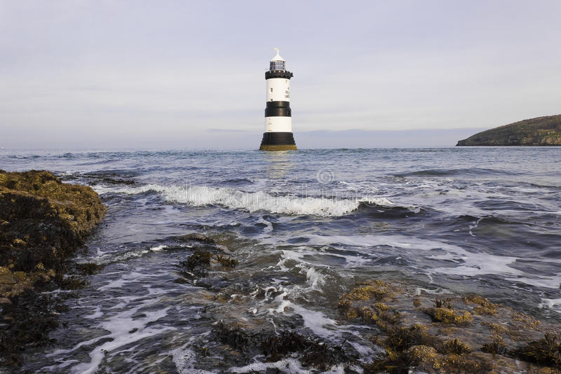 View of Penmon Lighthouse, Penmom Point, Isle of Anglesey, Wales. Looking northwards towards Penmon Lighthouse from Penmon Point, Isle of Anglesey, North Wales royalty free stock photos