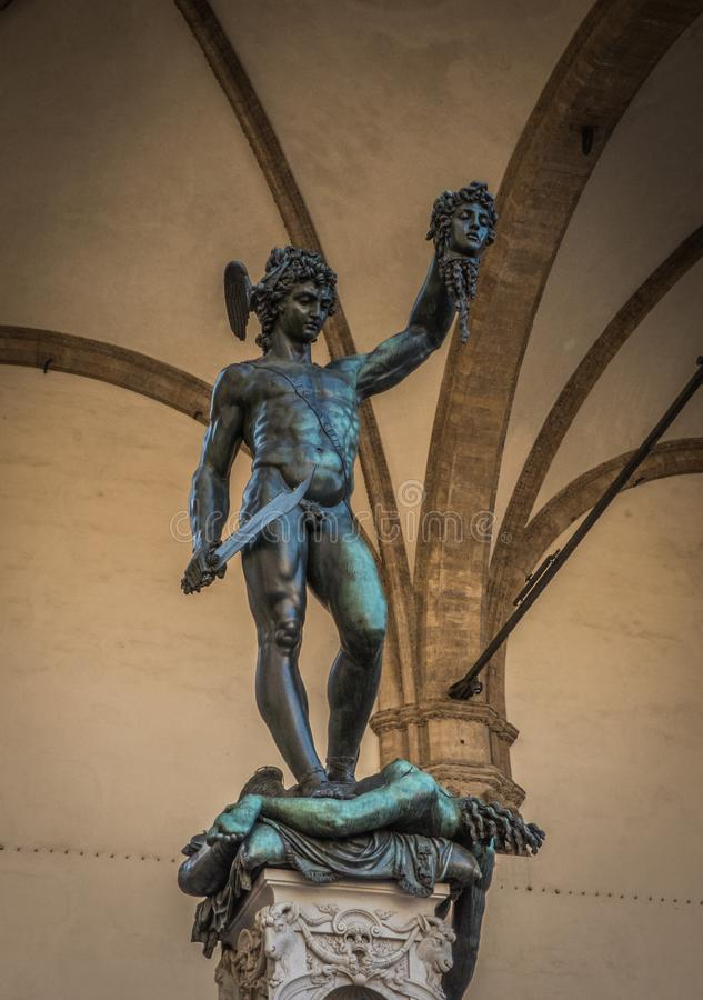 Perseus statue in Florence. View of the Perseus with the Head of Medusa statue by Benvenuto Cellini in the Loggia dei Lanzi gallery on the edge of the Piazza royalty free stock image