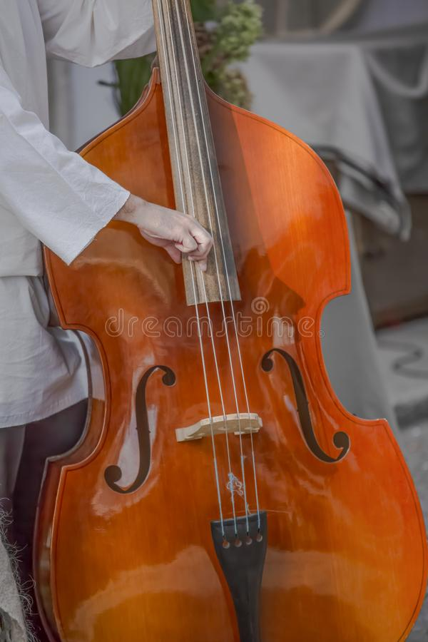 View of person playing double bass on the street.  stock image