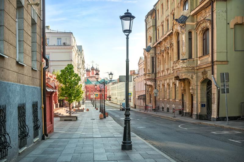 View of Petrovsky Lane in Moscow. Terentyev`s apartment building and the temple of the Petrovsky Monastery royalty free stock photos
