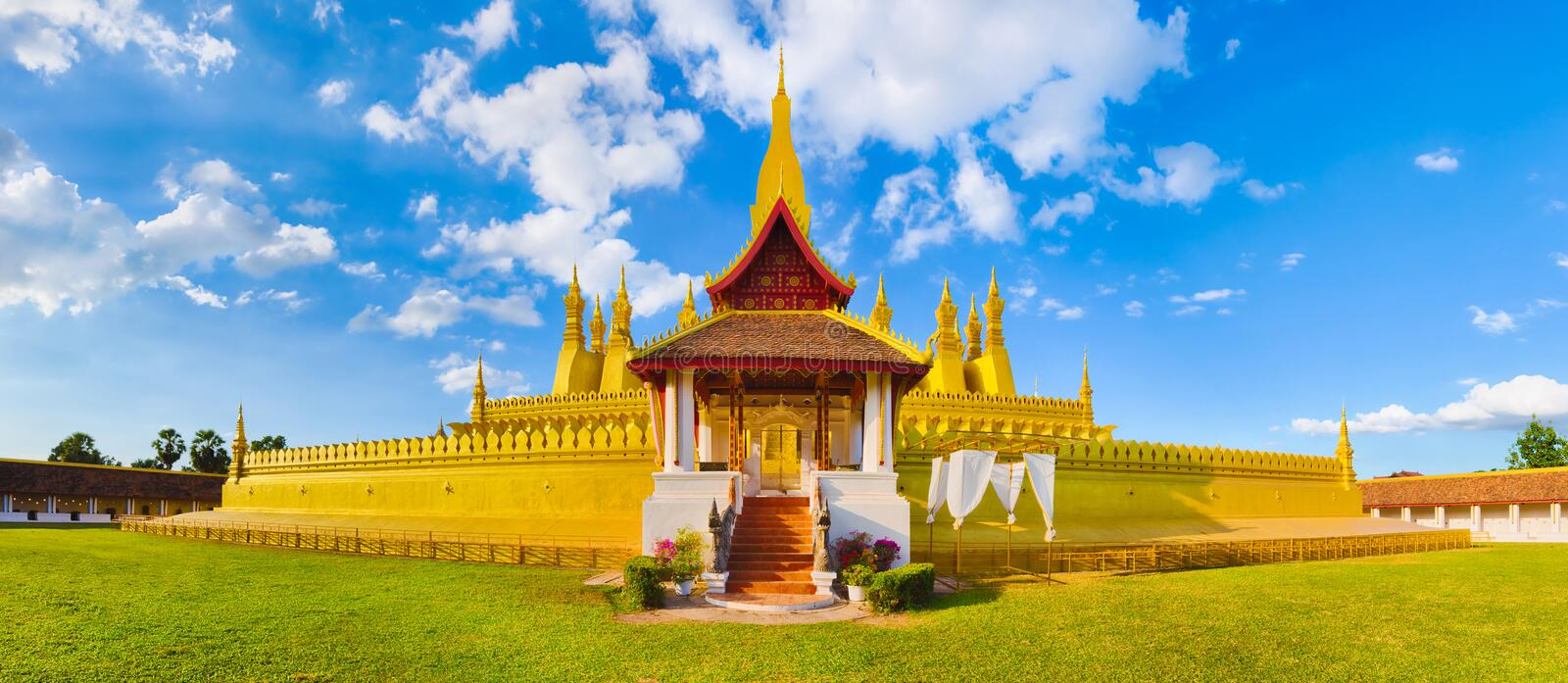 View of the Pha That temple. Vientiane, Laos. Panorama. Beautiful view of the Pha That temple. Vientiane, Laos. Panorama stock photo