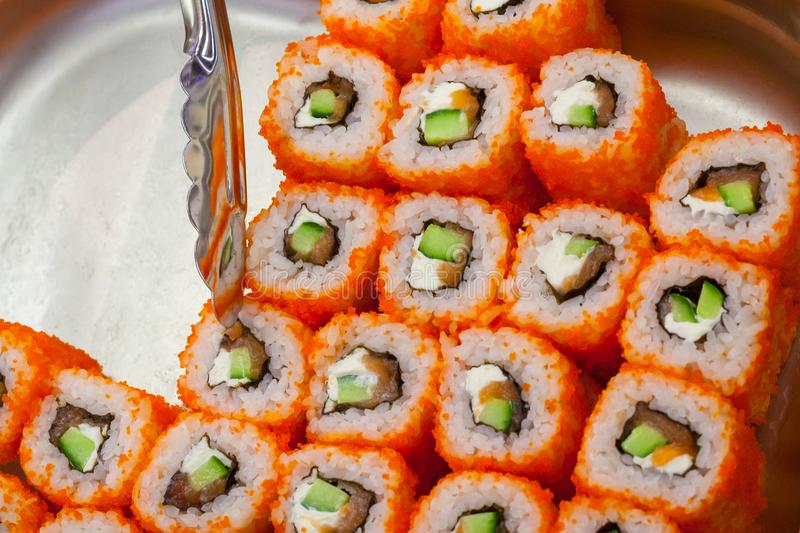 Philadelphia roll sushi on a counter in supermarket royalty free stock image