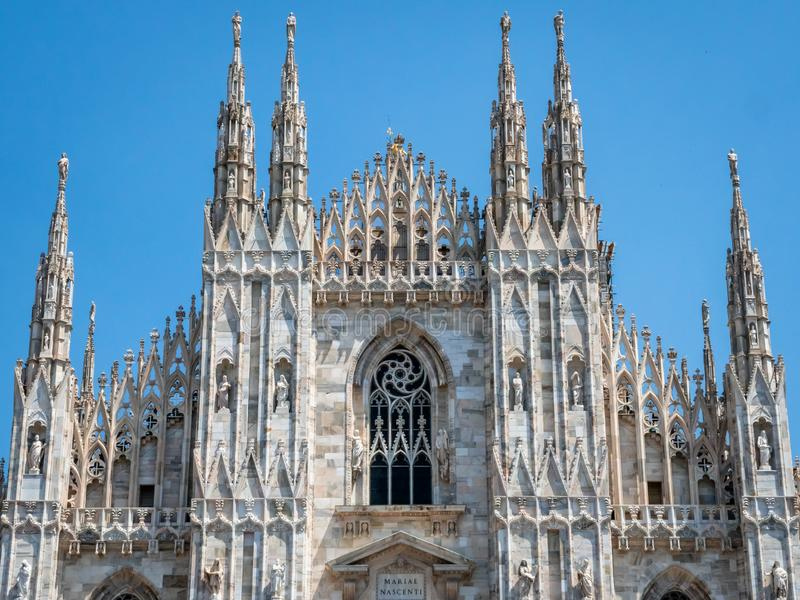 View of the Piazza del duomo the famous cathedral the Milano Duomo. Italian Religious Gothic Architecture. Milan, Italy - June 30, 2019: View of the Piazza del royalty free stock photography
