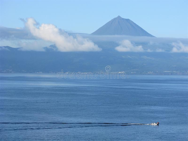 View of Pico volcano from Sao Jorge island, The Azores stock photography