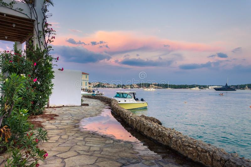 View of the picturesque coastal town of Porto Heli, Peloponnese. View of the picturesque natural harbor at the coastal town of Porto Heli, Peloponnese, Greece stock photography